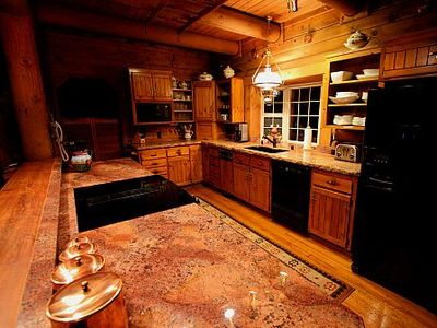 Open and airy kitchen features granite counter tops