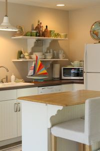 Kitchen has all new cabinets, appliances and a cute little repurposed island.