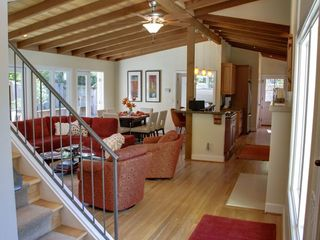 Pebble Beach house photo - Great Room with vaulted ceilings, fireplace, chef's kitchen and dining area.