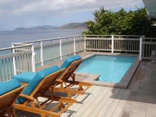 East End villa photo - Beautiful Down Island View from Lower Pool Deck with Lounge Chairs