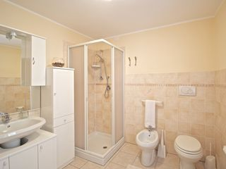 Treglio house photo - Main floor w/c complete with toilet, bidet, shower, and lots of storage