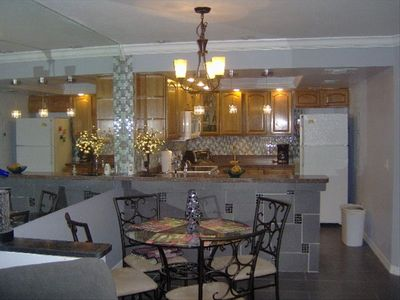 Dining area and fully equipt kitchen.