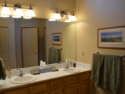 Upstairs full bathroom with tub and shower