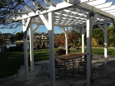Patio pergola - hard to see but lots of lights are hanging overhead.