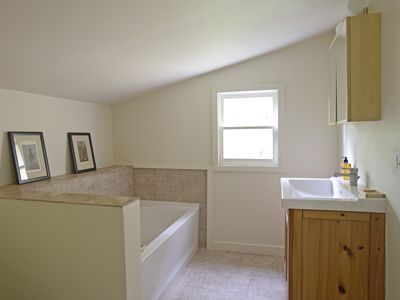 Soaking tub, separate full stall shower (not shown).