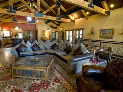Great Room in Main Lodge Opens to Kitchen Large Flat Screen TV