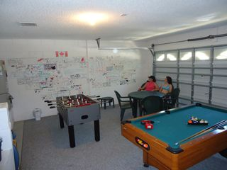 Indian Creek house photo - Our game room with wall of visitor comments. We love hearing from our guests.