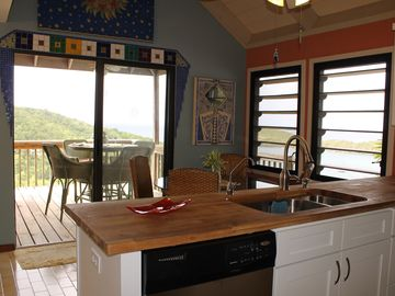 Overlook the inside and outside dining areas from the gourmet kitchen.