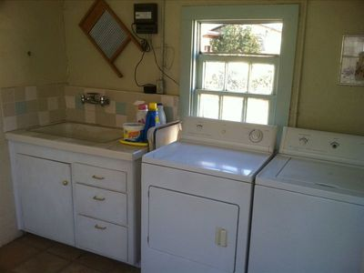 Laundry facilities housed in cute rock cottage in backyard