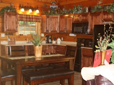 Fully stocked kitchen and dining area.