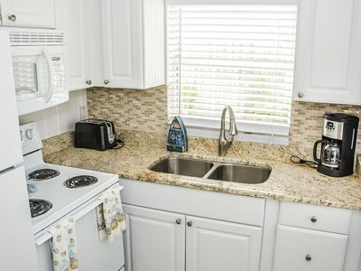 Cute kitchen with granite countertops