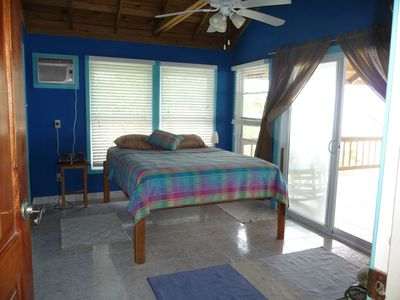 Sapphire Blue bedroom with patio door to large ceramic tiled covered deck