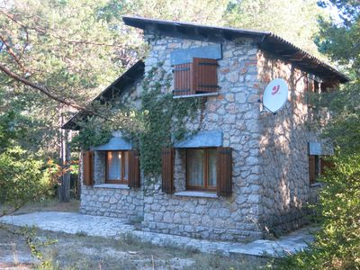 Chalet with fireplace surrounded by forest. Ideal for families
