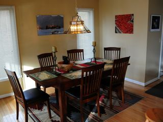 Swanton house photo - The dining table by the kitchen, leads to a screened in porch with table.