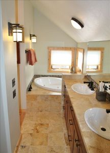 Master Bath with Jetted Tub, Travertine Marble throughout.