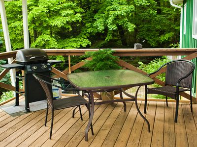 Relax On The Cool Deck Surrounded By Green!
