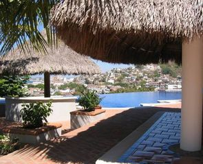 Puerto Vallarta condo photo - Pool deck Palapas with View over Infinity Edge