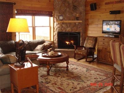 Beautiful cozy living room with fireplace and deck access