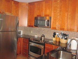Brand new kitchen with granite countertops and stainless steel appliances! - Brigantine condo vacation rental photo