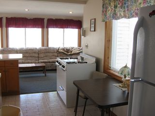 Weirs Beach house photo - Kitchen/family room area with table.