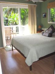 Sunset Beach house photo - Queen bed with ceiling fan and slider to lanai area