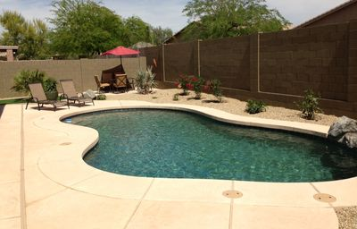 Pool with Waterfall and misting spray and cool patio deck also solar heat