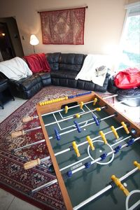 family room with HDTV, cable, Wii, foosball, pinball machine, and shuffle board