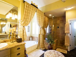 Austin estate photo - Master Bath with 2 vanity's, 3 head shower, bath tub, and walk-in closet