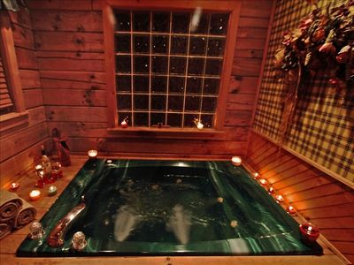 Jetted Jacuzzi for romantic coziness, candles on side for atmosphere.