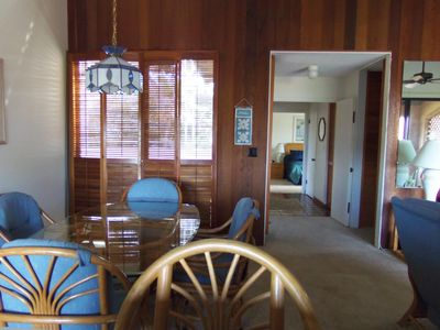Wailea condo rental - Dining room looking toward bedroom. Guest bath and laundry on right