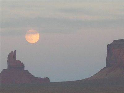 Our picture of the moon rise at nearby Monument Valley, Utah.