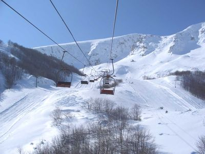 View from chairlift with quiet slopes