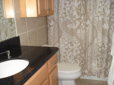 Punaluu condo rental - Beautiful bathroom w/tub & silestone thru-out
