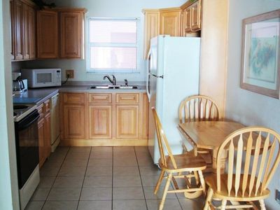 Remodeled eat-in kitchen has refrigerator with icemaker, dishwasher, micro