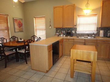 Kitchen with full size frig/ice maker, d/w, micro, all utensils & eat-in dining