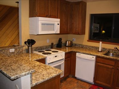 Brand New Kitchen, with new countertops, flooring, and appliances