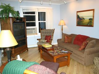 Lake Sinissippi cottage photo - Living Room w comfortable sofa sleeper/gliders, family games/Wifi/Cable tv/dvd.