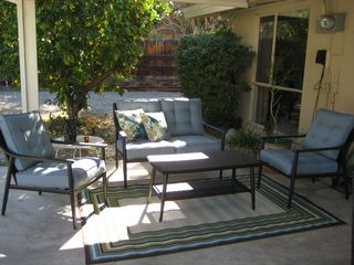 Rancho Mirage house photo - Shaded seating area under lanai.