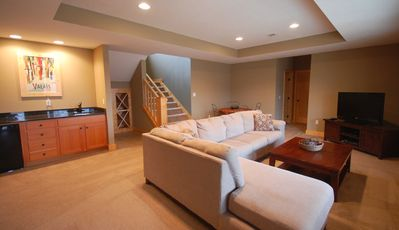 Lower Level Living Area - Large TV, Sectional, Table for playing cards and Bar.