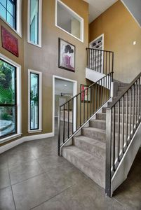 Stairway to 800 SQFT Master Suite.