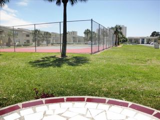 Gulf Highlands house photo - TENNIS ANYONE? The courts are at your back door.