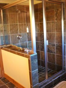 Master bath walk in shower.  Also has an elevated soaking tub.