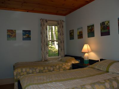 Twin bedroom with woods view to the east; north window with water view not shown
