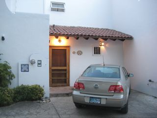 Park right at your door. - Bucerias townhome vacation rental photo