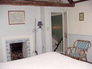 Wellfleet house photo - 2nd floor bedroom with cathedral ceiling showing fireplace