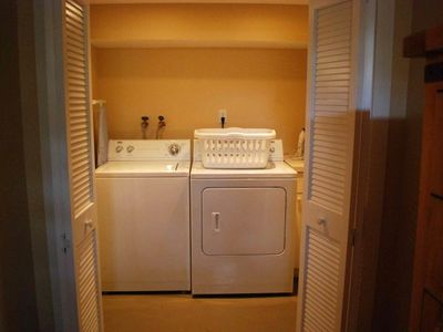 Well lit laundry room with new washer/dryer and we supply the laundry soap.