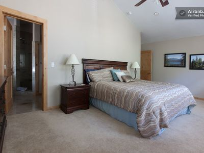 Master bedroom with king size bed and master bath