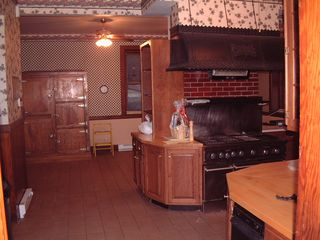 Newport chalet photo - Big kitchen, stove with grill and griddle, table for 8 next to original ice box.