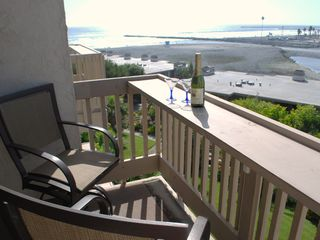 Oceanside condo photo - Relax at the living room balcony & bar
