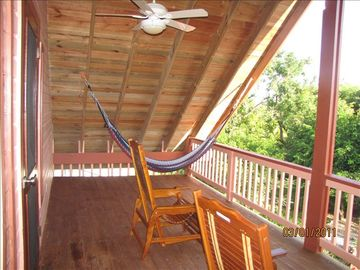 deck off of master bedroom there are 2 hammocks and 2 reclining deck chairs